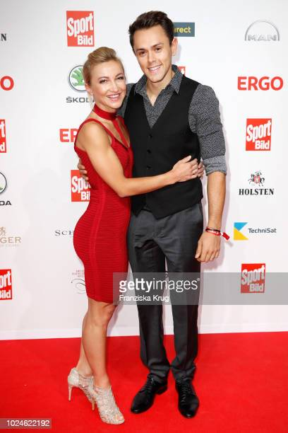 Figure skaters Aljona Savchenko and her husband Liam Cross attend the Sport Bild Award on August 27 2018 in Hamburg Germany