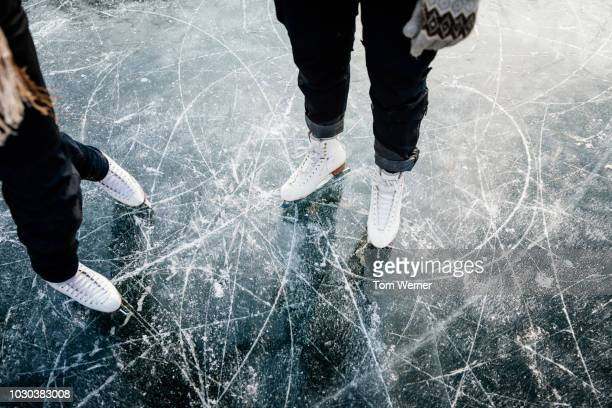 figure skater's ice skates from above - wintersport stock-fotos und bilder
