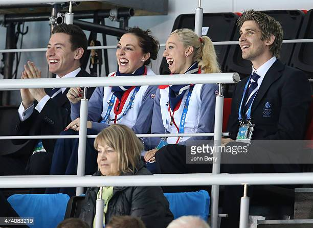 Figure skaters Jenna McCorkell Stacey Kemp and David King of Great Britain support Team GB during the Men's Gold Medal match between Canada and Great...