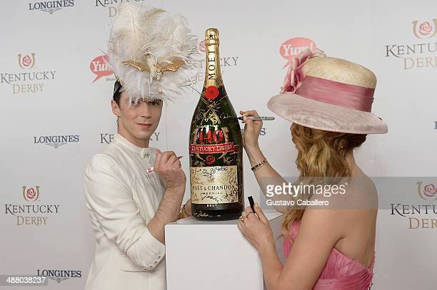 Figure Skaters Johnny Weir and Tara Lipinski toast with Moet Chandon at the 140th Kentucky Derby at Churchill Downs on May 3 2014 in Louisville...