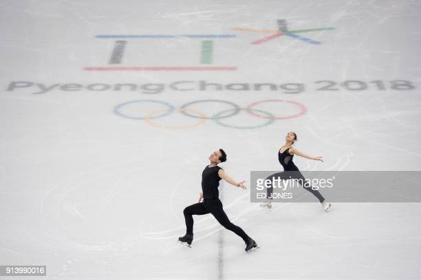 Figure skaters Kim Ju-Sik and Ryom Tae-Ok of North Korea attend a practice session at the Gangneung Ice Arena in Gangneung prior to the Pyeongchang...