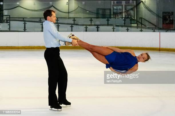 Figure skaters Mark Hanretty and Nina Ulanova perform during final rehearsals for the world premiere ice skating performance of The Creative Spirit...