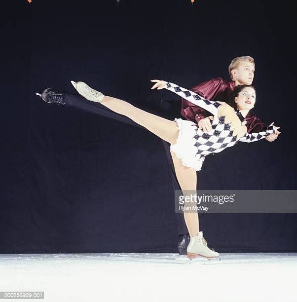 Figure skaters performing on ice