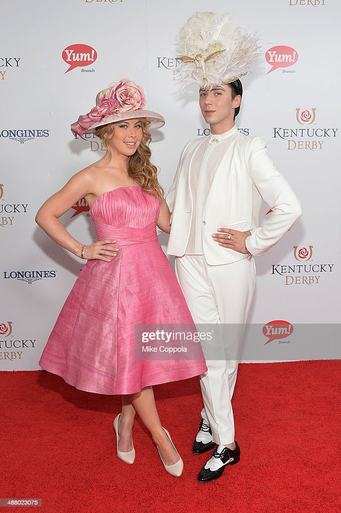 Figure skaters Tara Lipinski (L) and Johnny Weir attend 140th Kentucky Derby at Churchill Downs on May 3, 2014 in Louisville, Kentucky.