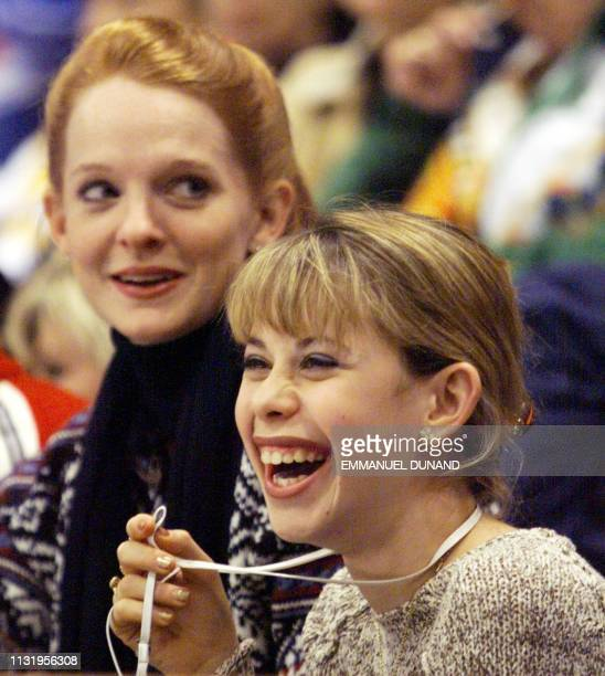 US figure skaters Tara Lipinsky and Jenni Meno watch the men's free skating competition of the XVIII Winter Olympics14 February at White Ring arena...