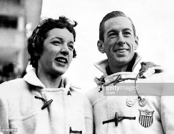 Figure skaters Tenley Albright and Hayes Alan Jenkins of the United States smile as they pose during the Winter Olympic Games 04 February 1956 in...