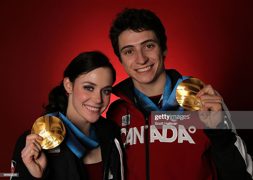 Figure skaters Tessa Virtue (L) and Scott Moir of Canada pose with their ice dance gold medals in the NBC Today Show Studio at Grouse Mountain on February 23, 2010 in North Vancouver, Canada.