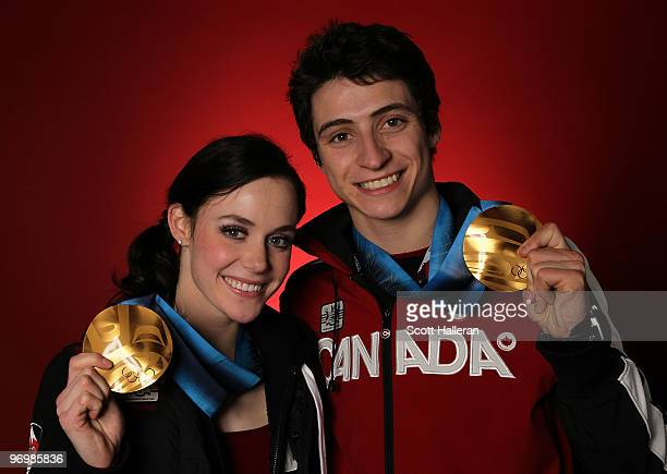 Figure skaters Tessa Virtue and Scott Moir of Canada pose with their ice dance gold medals in the NBC Today Show Studio at Grouse Mountain on...