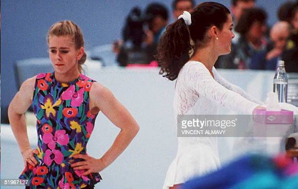US figure skaters Tonya Harding and Nancy Kerrigan avoid each other during a training session 17 February in Hamar Norway during the Winter Olympics...