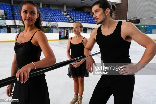 Figure skaters Vanessa Bauer Nina Ulanova and John Kerr wait to perform during final rehearsals for the world premiere ice skating performance of The...