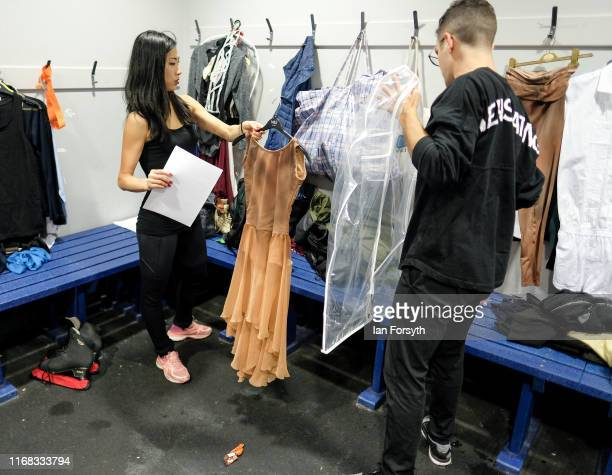 Figure skaters Yebin Mok and Mauro Bruni prepare costume changes during final rehearsals for the world premiere ice skating performance of The...