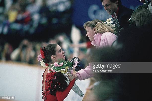 Figure Skating 1988 Winter Olympics Closeup of East Germany Katarina Witt victorious with fan and flowers after winning free program Calgary CAN...