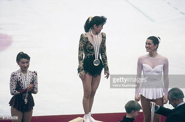 Figure Skating 1992 Winter Olympics JPN Midori Ito USA Kristi Yamaguchi and USA Nancy Kerrigan victorious with medals after freestyle competition...