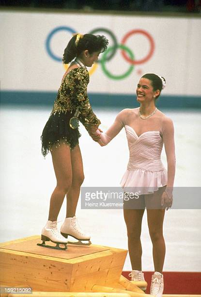 1992 Winter Olympics USA Kristi Yamaguchi and Nancy Kerrigan on medal stand after Women's Singles Free Skating Finals at Olympic Ice Hall Albertvile...