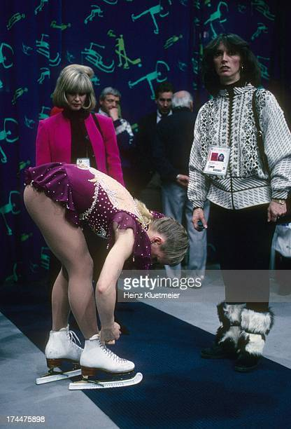 1994 Winter Olympics USA Tonya Harding trying to repair skate lace with coach Diane Rawlinson before Women's Free Skating program at Olympic...