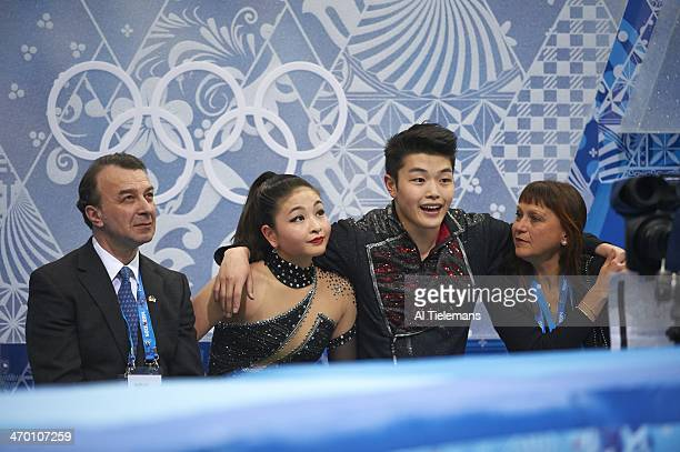 2014 Winter Olympics USA Maia Shibutani and Alex Shibutani awaiting scores with coach Marina Zueva and coach Oleg Epstein during Ice Dance Free Dance...