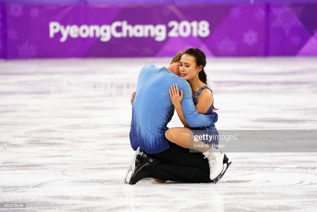 USA Madison Chock and Evan Bates victorious, hugging at the end of Ice Dance Free Dance at Gangneung Ice Arena. Erick W. Rasco X161686 TK1 )