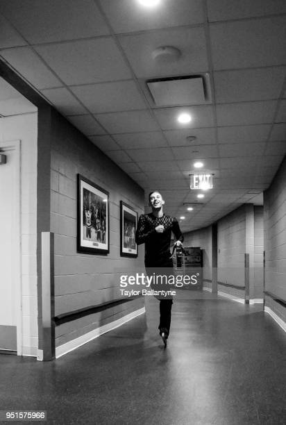 Adam Rippon running through runway on way to ice during practice session before filming of Stars on Ice television show at Nassau Veterans Memorial...