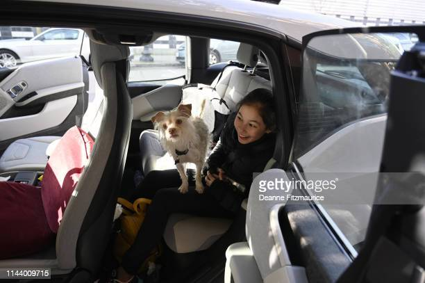 Alysa Liu in car with her dog before training session photo shoot A Day in the Life Oakland CA CREDIT Deanne Fitzmaurice