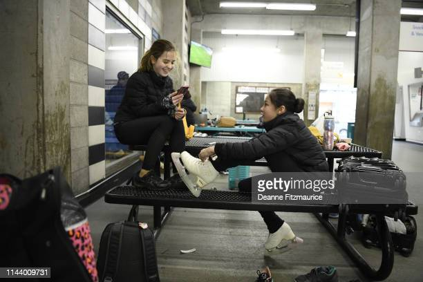 Alysa Liu lacing up with her friend Juliana before practice session photo shoot A Day in the Life Oakland CA CREDIT Deanne Fitzmaurice