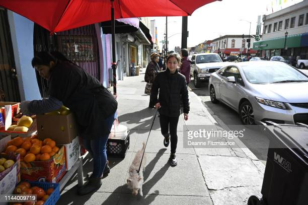 Alysa Liu outside during photo shoot in Chinatown neighborhood A Day in the Life Oakland CA CREDIT Deanne Fitzmaurice