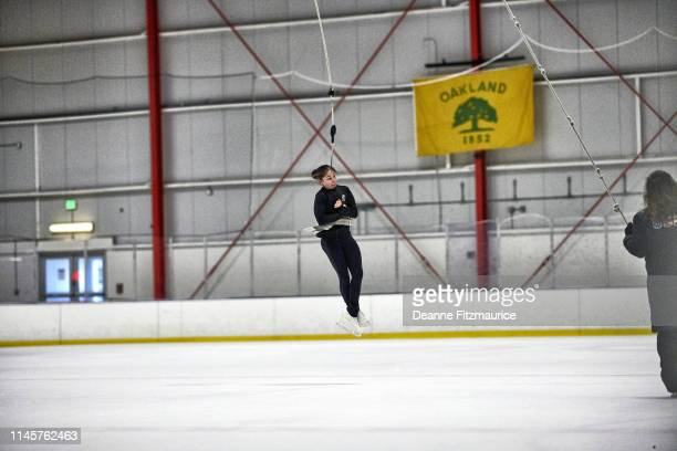 Alysa Liu using a harness to practice jumps during practice session photo shoot A Day in the Life Oakland CA CREDIT Deanne Fitzmaurice