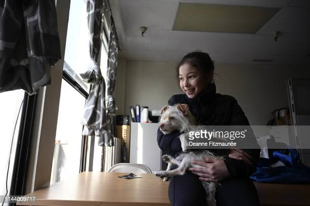 Alysa Liu with her dog during photo shoot at home A Day in the Life Oakland CA CREDIT Deanne Fitzmaurice