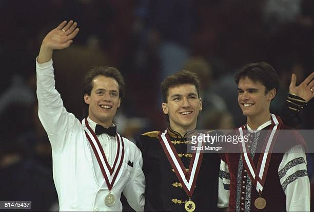 Figure Skating CAN Championships Closeup of Kurt Browning and Elvis Stojko victorious with medals on stand Edmonton CAN 1/15/1994