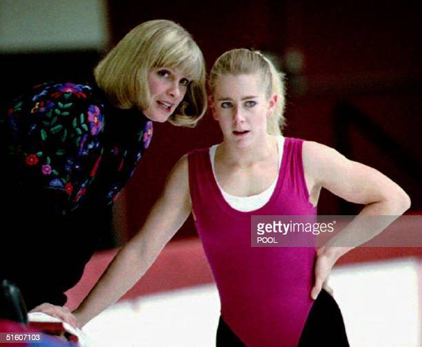 S figure skating champion Tonya Harding listens to her coach Diane Rawlinson during a practice session early 18 January 1994 in Portland Oregon...