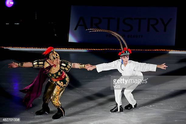 Figure skating champions Johnny Weir and Zhang Hao perform during Artistry On Ice 2014 at MasterCard Center on July 25 2014 in Beijing China