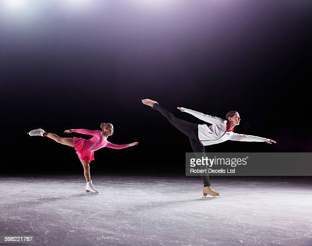 figure skating coach demonstrating to pupil - figure skating stock pictures, royalty-free photos & images