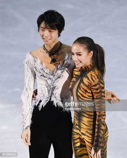 Figure skating gold medalists Yuzuru Hanyu of Japan and Alina Zagitova an Olympic Athlete from Russia pose for a photo after the exhibition gala at...