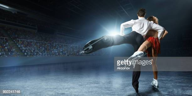 figure skating. ice skaters couple - figure skating stock pictures, royalty-free photos & images