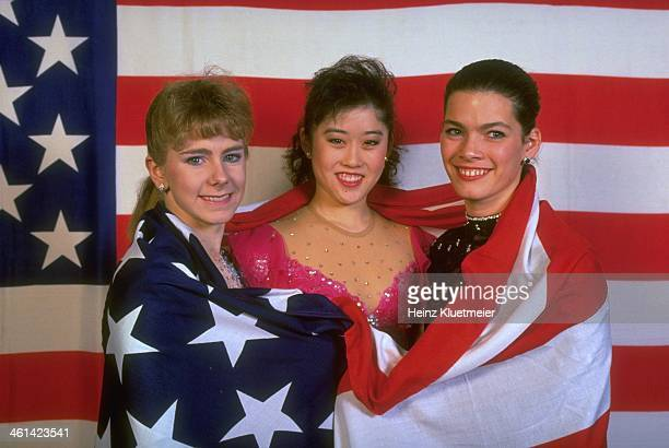 ISU World Championships Portrait of USA Tonya Harding Kristi Yamaguchi and Nancy Kerrigan posing with American flag at Olympia Eisstadion Munich...