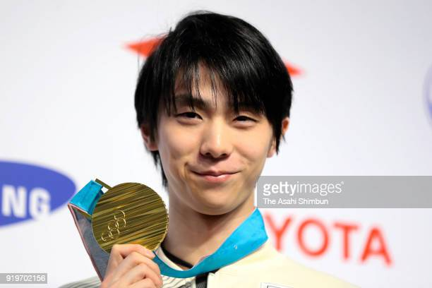 Figure Skating Men's Single Gold medalist Yuzuru Hanyu of Japan poses for photographs during a press conference on day nine of the PyeongChang Winter...
