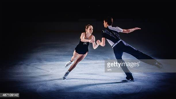 Figure skating pair performing