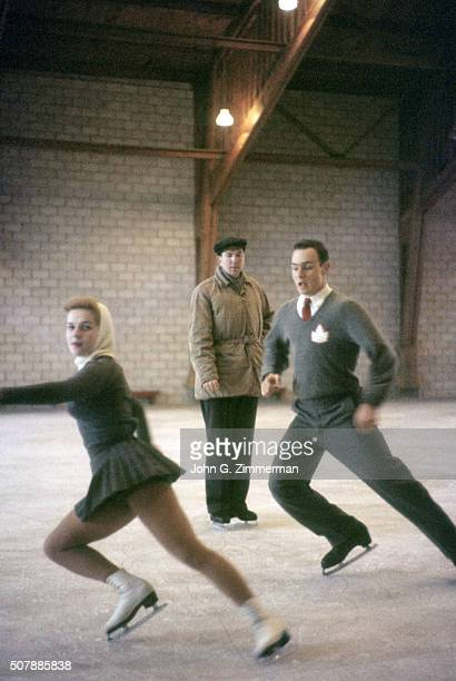 Portrait of coach Sheldon Galbraith watching for flaws in synchronization as his world champions Bob Paul and Barbara Wagner move into high speed...