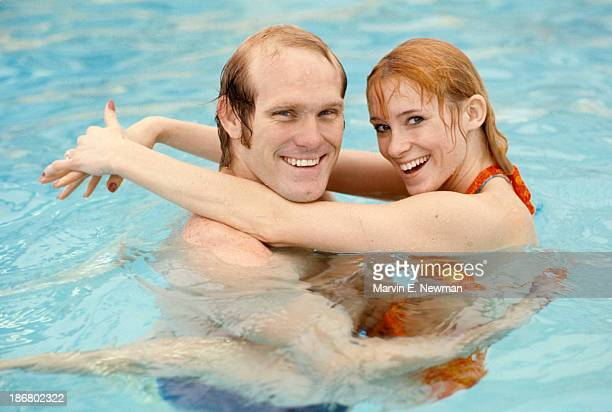 Portrait of JoJo Starbuck with fiance Pittsburgh Steelers QB Terry Bradshaw casual in pool during photo shoot New York NY CREDIT Marvin E Newman