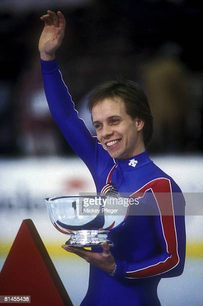 Figure Skating US Championships Closeup of Scott Hamilton victorious with trophy after winning Long Program Salt Lake City UT 1/22/1984