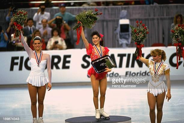 US Championships Nancy Kerrigan Kristi Yamaguchi and Tonya Harding during medal ceremony at Orlando Arena Yamaguchi holding trophy Orlando FL CREDIT...