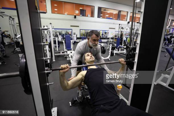 Winter Games Preview Closeup of ice dancer Zachary Donohue lifting weights during training session at Centre Gadbois Behind the Scenes Montreal...