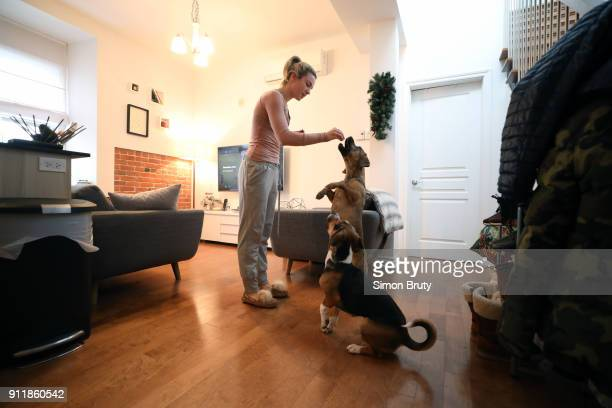Winter Games Preview View of ice dancer Madison Hubbell with her dogs during photo shop at home Behind the Scenes Montreal Canada 1/19/2018 CREDIT...