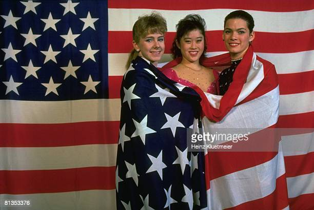 Figure Skating World Championships Portrait of USA Tonya Harding Kristi Yamaguchi and Nancy Kerrigan with USA flag at Olympia Eisstadion Munich...