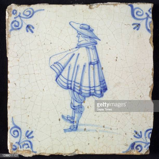 Figure tile, blue with nobleman with wide cape and big hat, corner pattern ox's head, wall tile tile sculpture ceramic earthenware glaze, baked 2x...