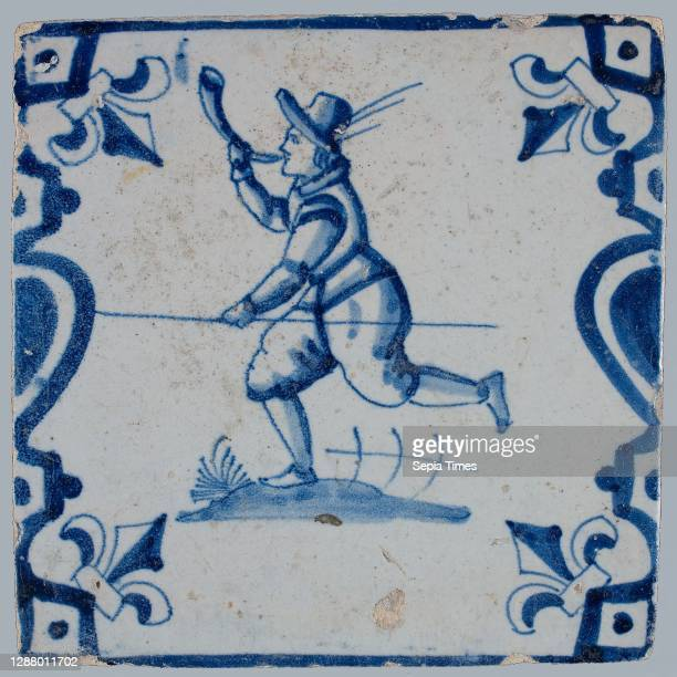 Figure tile, hunting scene, blue with float with hunting horn and stick, between balusters with lily, wall tile tile sculpture ceramic earthenware...