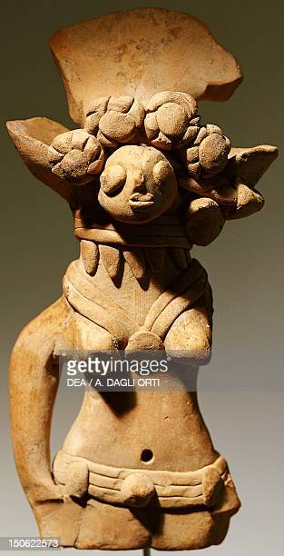 Figure with headdress of flowers rings and belt terracotta statue from Harappa Pakistan Indus Valley Civilisation