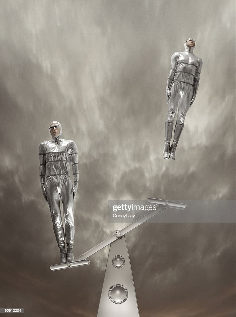 Figures launching off futuristic seesaw : Stock Photo