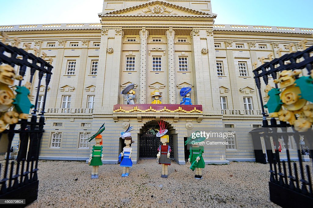 LEGO figures of Camilla, Duchess of Cornwall, Queen Elizabeth II, Catherine, Duchess of Cambridge, Princess Beatrice, Princess Eugenie, Zara Tindall and Carole Middleton stand outside a LEGO Buckingham Palace wearing designer hats by Rachel Trevor-Morgan, The Queen's milliner ahead of Royal Ascot at LEGOLAND Windsor on June 10, 2014 in Windsor, England.