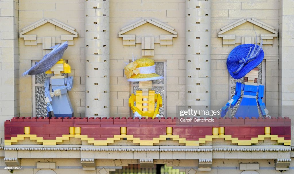 LEGO figures of Camilla, Duchess of Cornwall, Queen Elizabeth II, Catherine, Duchess of Cambridge stand outside a LEGO Buckingham Palace wearing designer hats by Rachel Trevor-Morgan, The Queen's milliner ahead of Royal Ascot at LEGOLAND Windsor on June 10, 2014 in Windsor, England.