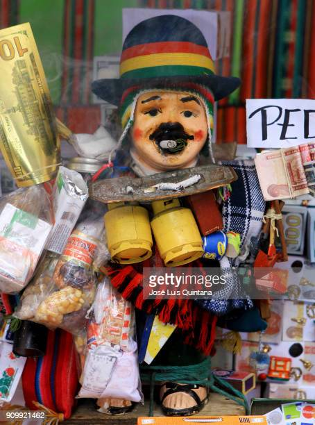 Figures of Ekekos the Aymara god of abundance are displayed for sale during the Alasitas festival on January 24 2018 in La Paz Bolivia Alasitas...